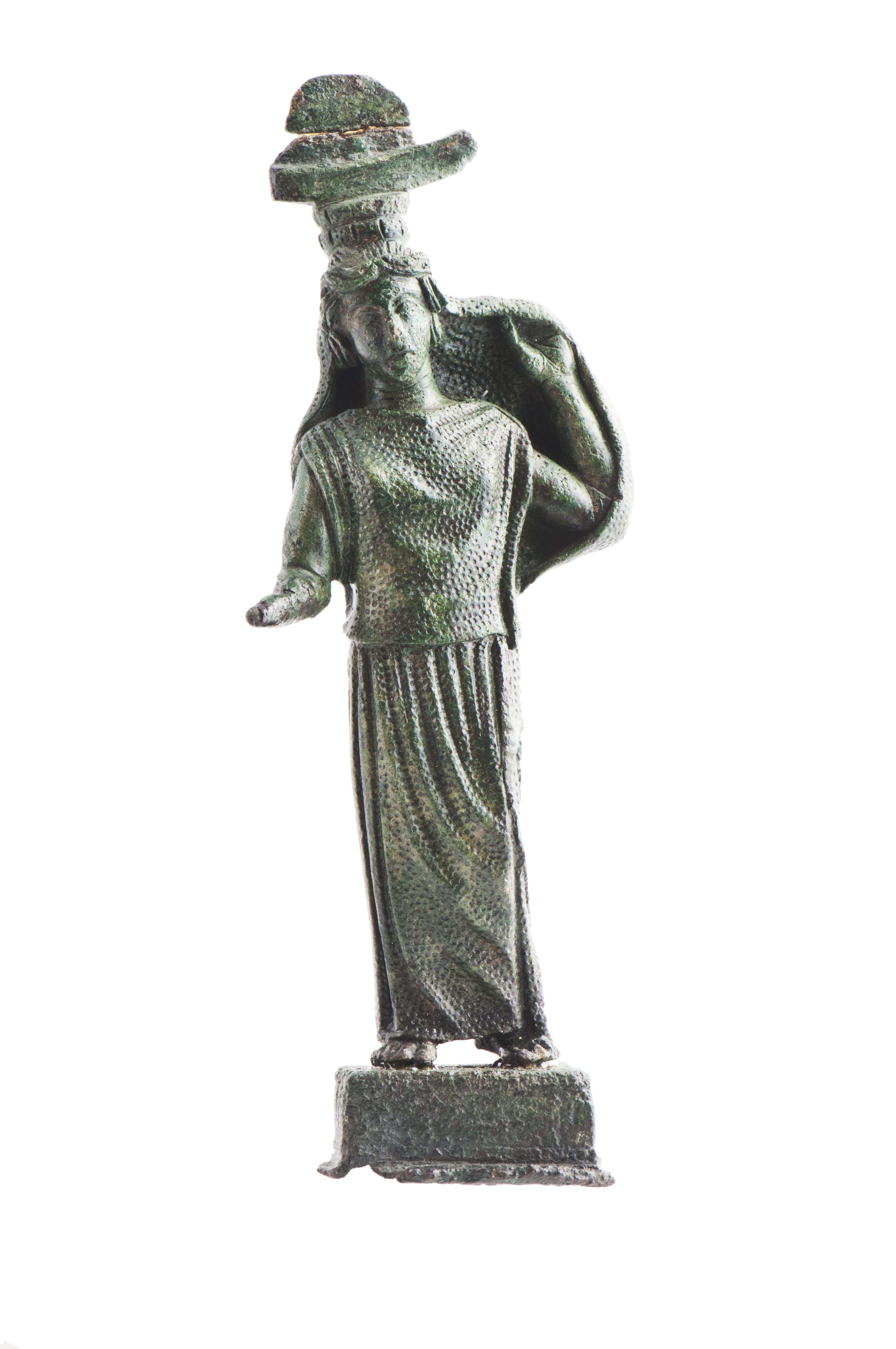 fig. 77 Sostegno di specchio in bronzo